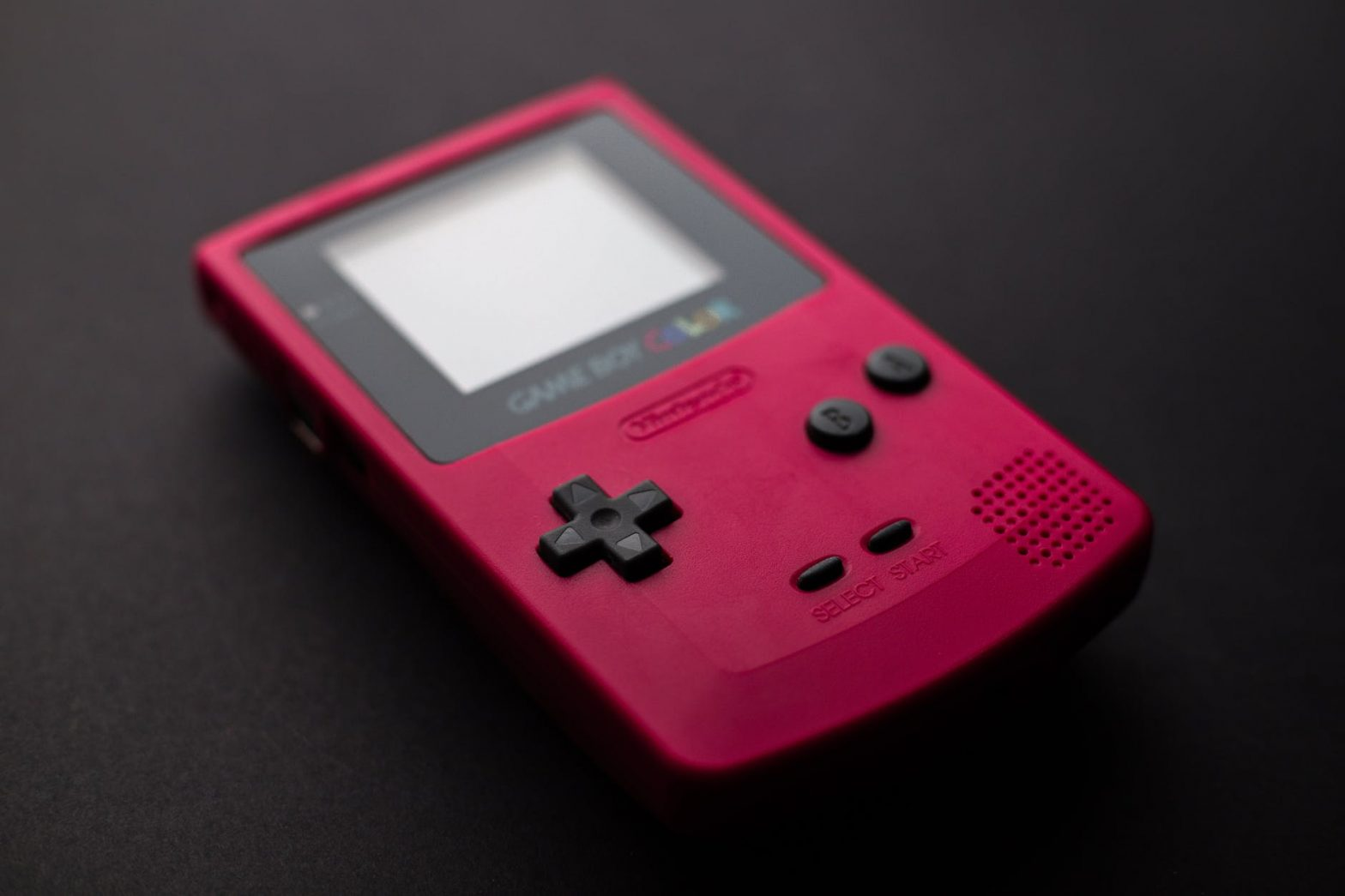 close up photo of red game boy console